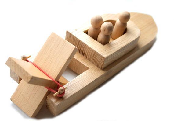 bote juguete de madera propela goma elastico flota